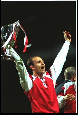 former arsenal legend , current under 18 manager.